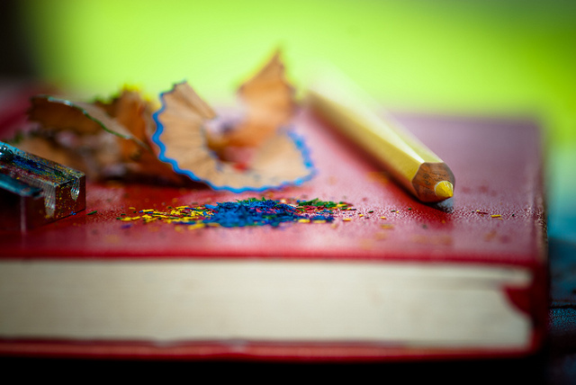 Image of sketch book with coloured pencils.